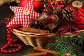Christmas decorations in basket and spruce branches — Stock Photo