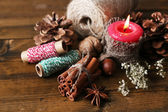 Composition with natural bump, candle, thread, cinnamon sticks — Stock Photo