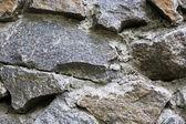 Background of stone wall texture — Stockfoto