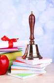 Gold school bell with school supplies — Stock Photo