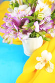 Bouquet of freesias in pail on table close-up — Stock Photo