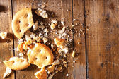 Crushed cookie on wooden background — Stock Photo