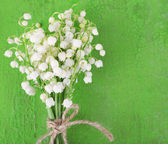 Beautiful lilies of the valley on old wooden background — Zdjęcie stockowe