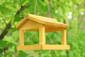 Birdhouse in garden outdoors — Stock Photo