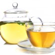 Composition of fresh mint tea in glass cup and teapot and brown sugar isolated on white — Stock Photo #47556323
