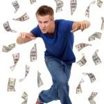 Happy man enjoying rain of money, isolated on white — Stock Photo #47557397