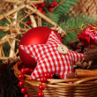 Christmas decorations in basket and spruce branches close up — Stock Photo #47558019