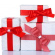 Beautiful gifts with red ribbons, isolated on white — Stock Photo #47559939