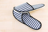Striped slippers on wooden background — Photo