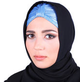Beautiful muslim arabic woman on grey background — Stockfoto
