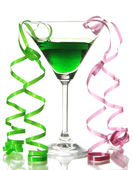 Glass of cocktail and streamer after party isolated on white — 图库照片