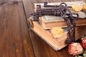 Beautiful composition with old key and old books on wooden background — Zdjęcie stockowe