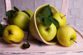 Beautiful still life with ripe sweet apples and leaves  — Stock Photo