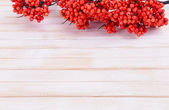 Artificial berries, on wooden background — Stock Photo