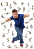 Happy man enjoying rain of money, isolated on white — Стоковое фото