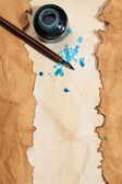 Frame of old paper with ink on wooden background — Stock Photo
