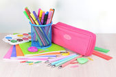 Bright school supplies on table on light background — Stock Photo