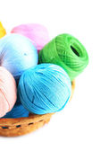 Colorful yarn balls for knitting in wicker basket, isolated on white — Stock fotografie