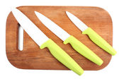 Kitchen knives and cutting board isolated on white — Stock Photo