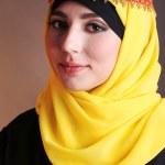 Beautiful muslim arabic woman on dark color background — Stock Photo #47561283