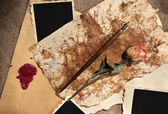 Composition with blank old photos, paper, letters on sackcloth background — Foto Stock