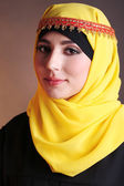 Beautiful muslim arabic woman on dark color background — Foto de Stock