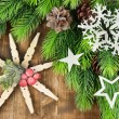 Beautiful snowflakes with fir branch on wooden background — Stock Photo #47839335