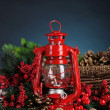 Red kerosene lamp on dark color background — Stock Photo #47839415