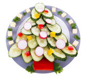 Christmas tree from cucumber on plate isolated on white — 图库照片