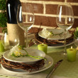 Beautiful holiday Easter table setting in green tones, on bright background — Foto de Stock