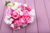 Beautiful wedding bouquet on wooden background — Stock Photo