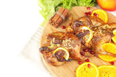 Roasted quails  on cutting board, isolated on white — Stock Photo