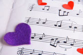 Decorative hearts on music book, close-up — Stock Photo