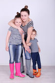 Beautiful small girls with mother in room — Stock Photo
