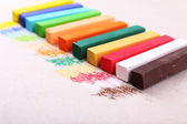 Colorful chalk pastels on color paper background — Stock Photo