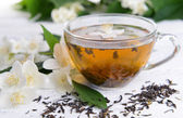 Cup of tea with jasmine on table close-up — Stock Photo