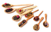 Assortment of dry tea in wooden spoons,  isolated on white — Stock Photo