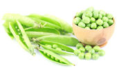 Fresh green peas in wooden bowl, isolated on white background — Stock Photo