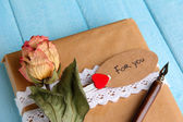 Natural style handcrafted gift box on color wooden background. Concept of natural style design — Foto Stock