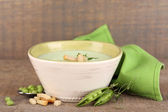 Tasty peas soup on wooden table — Stock Photo