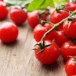 Fresh cherry tomatoes on old wooden table — Stock Photo #47906853