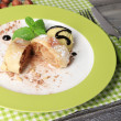 Tasty homemade apple strudel with nuts, mint leaves and ice-cream on plate, on wooden background — Stock Photo