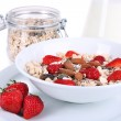 Healthy cereal in bowl with milk and strawberries closeup — Stock Photo #47906873