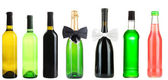 Collage of different alcohol bottles isolated on white — Stock Photo