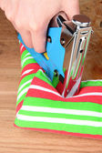 Fastening fabric and board using construction stapler — Stok fotoğraf