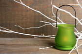 Bright icon-lamp with branches on wooden background  — Stock Photo