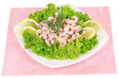 Delicious marinated shrimp in plate isolated on white — Stock Photo