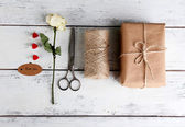 Natural style handcrafted gift box on wooden background. Concept of natural style design — Stock Photo