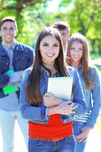 Happy students in park — Stock Photo