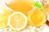 Sweet honey with lemon close up — Stock Photo